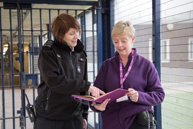 a prison officer and probation officer talking