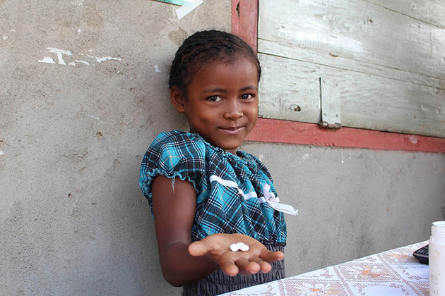 A young girl is given treatment to prevent Schistosomiasis, funded by by UK aid. Picture: SCI