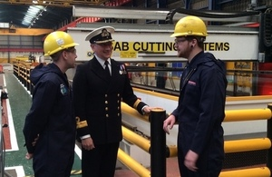 Commodore Peter Coulson talking to workers at Govan shipyard, where the first sheet of steel was cut for HMS Spey.