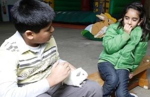 Children with guinea pig