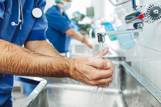 Surgeon washing hands