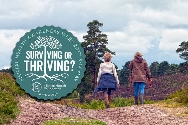 Two people walking in countryside with Mental Health Awareness Week 2017 badge superimposed.