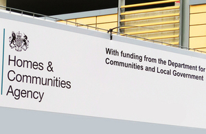 Homes and Communities Agency sign