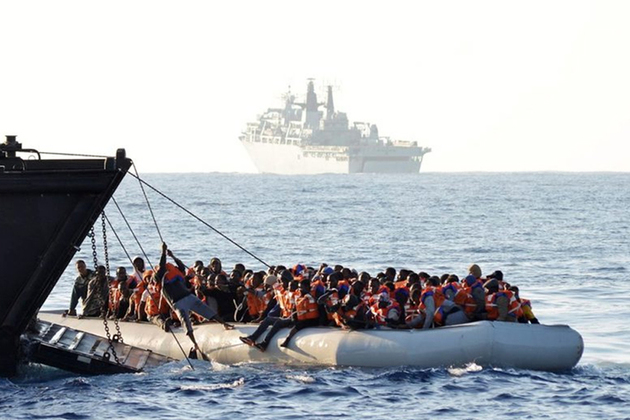 People are rescued from an inflatable boat by the Royal Navy in the central Mediterranean, June 2017. Picture: Royal Navy/ET WE CIS Louise George