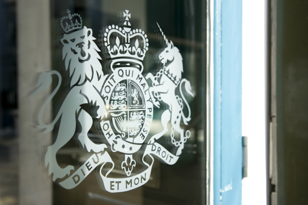 Image of HM Government sign on glass door