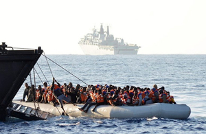 People are rescued from an inflatable boat by the Royal Navy in the Mediterranean, June 2017.