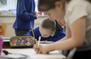 Female pupils writing