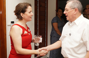 High Commissioner Melanie Hopkins greets Acting President and Chief Justice, Hon Justice Anthony Gates
