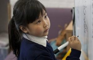 Girl writing on board