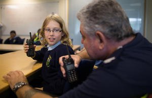 image of operations manager explaining  the workings of the team to St Werburgh's schoolchildren