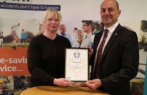 Clare Read, Head of Regional Health and Safety Support Team, and Geoff Robson, Chief Operating Officer, with the RoSPA Gold Award. Crown Copyright MOD 2017. All rights reserved.