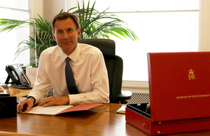 Jeremy Hunt as his desk
