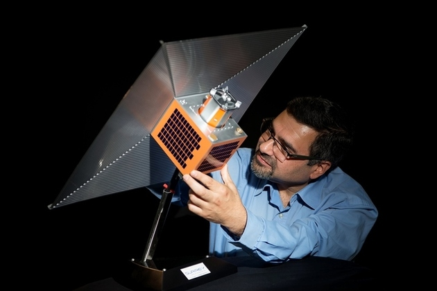 Image of a satellite with the space sail