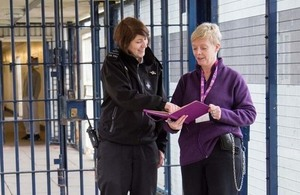 a prison officer and a probation officer working together