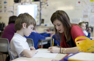 teacher helping a child in the classroom