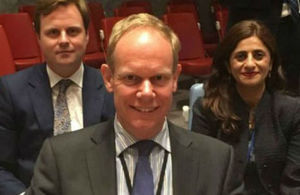 British Ambassador to the UN flanked by colleagues.
