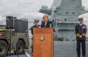 Theresa May speaking on board the HMS Queen Elizabeth