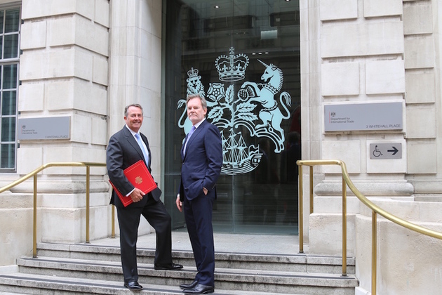 Picture of Dr Liam Fox welcoming Crawford Falconer outside the Department for International Trade