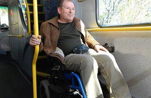 Man in wheelchair on bus