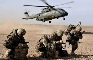Members of II Squadron, RAF Regiment, Force Protection for Camp Bastion, Afghanistan are pictured as an RAF Merlin Helicopter arrives. Crown Copyright. Photo: via MOD.