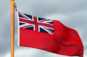 Image of the Red Ensign flag flying.