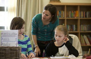 Teacher talking to students