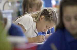 female pupil writing