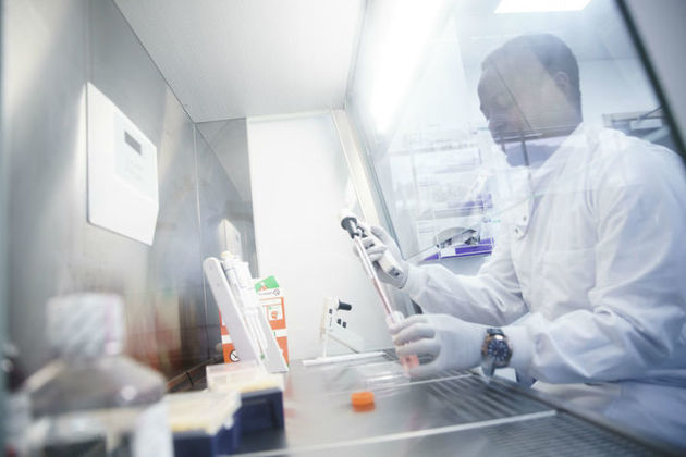 Autolus Operations Assistant Precious Koto works at the laboratory in London