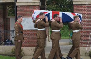 Royal Anglian Regiment bring a coffin into the cemetery - Crown Copyright, All Rights Reserved