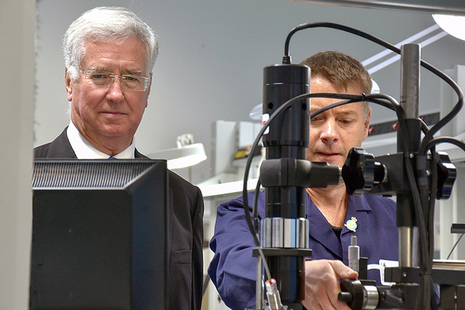 Secretary of State for Defence Rt Hon Sir Michael Fallon getting hands on experience of DECA's surface mount repair capability in the dedicated DECA Capability Development training area with Rich Smith.  Copyright DECA