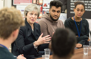 Theresa May speaking with young people at Dunraven School