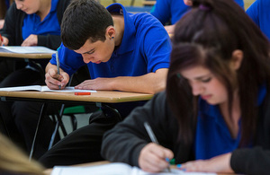 Students at desks sitting an exam.