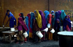 Young girls line up at a feeding centre in Mogadishu. UN Photo/Tobin Jones