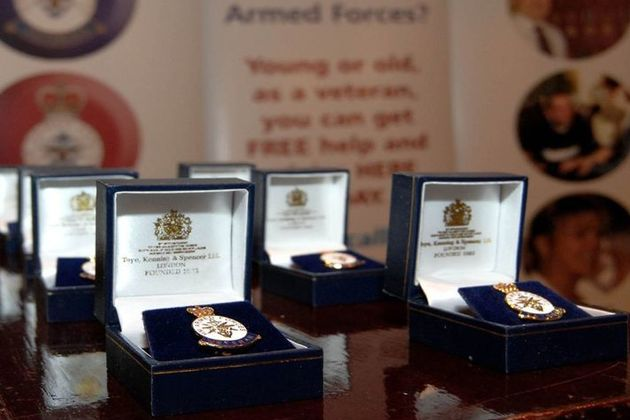 UK Armed Forces Veterans' Badges are lined up ready for issue. Crown Copyright. All rights reserved.