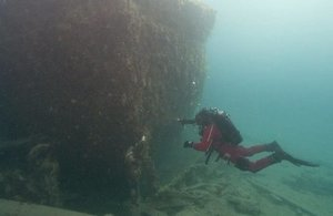 Diver swimming among the wreckage of HMS Erebus