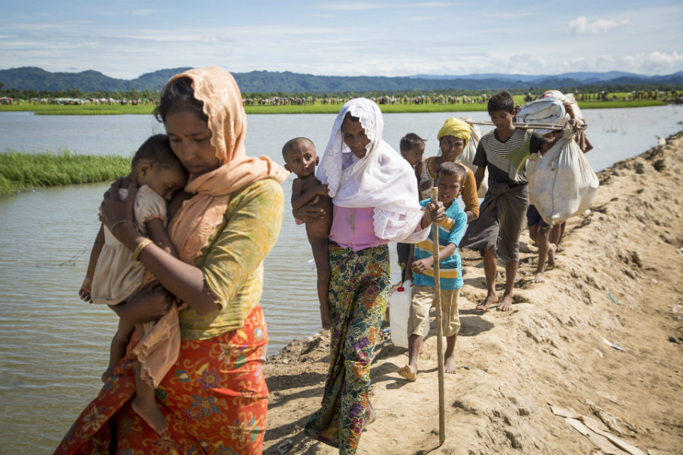 Rohingya families arrive at a UNHCR transit centre near the village of Anjuman Para, Cox's Bazar, south-east Bangladesh after spending four days stranded at the Myanmar border with some 6,800 refugees. Photo: UNHCR/Roger Arnold
