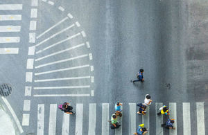 Aerial view of people crossing a road