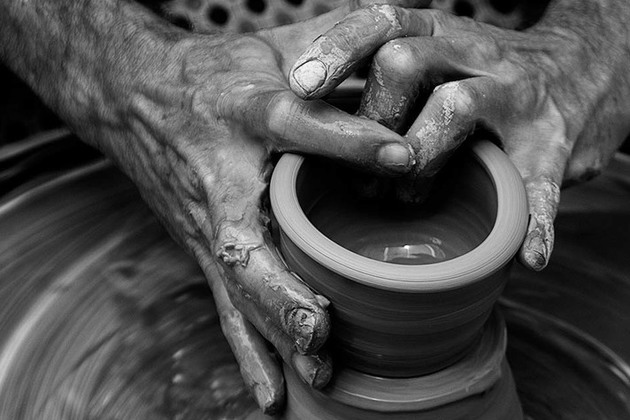 Potter shaping a clay pot
