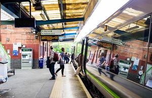 Passengers at at railway station.