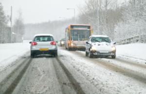 Vehicles driving in snow