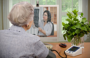 Older person speaking to their GP over a webcam.
