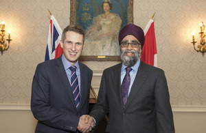 Defense Secretary shaking hands with Canadian Minister of Defence