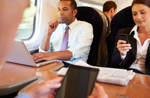 people using devices on a train