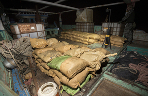 Parcels of seized narcotics lay on the deck of the smuggling vessel. Crown copyright.