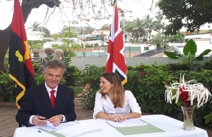 Ambassador John Dennis and Filipa Lima signing the project contract for business arbitration in Angola