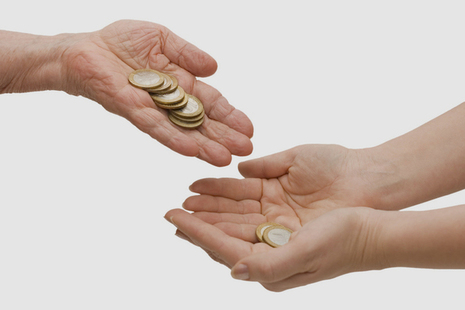 Hands exchanging coins