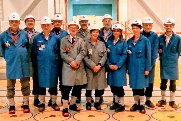 Committee members standing in Sellafield.