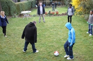 Children playing football in garden