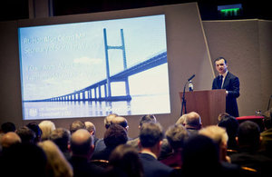 Alun Cairns speaking to guests at the Severn Growth Summit