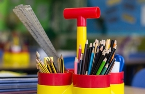 Pens and pencils in a holder in a school classroom